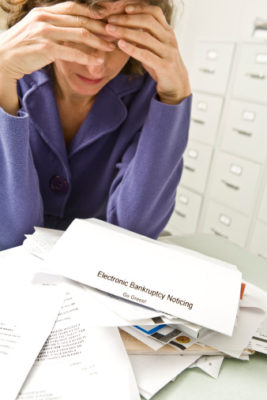 Distraught woman with bankruptcy notice